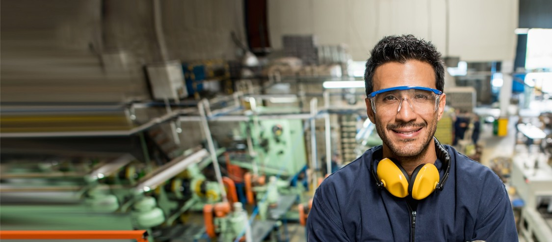 Employee in manufacturing plant with safety gear