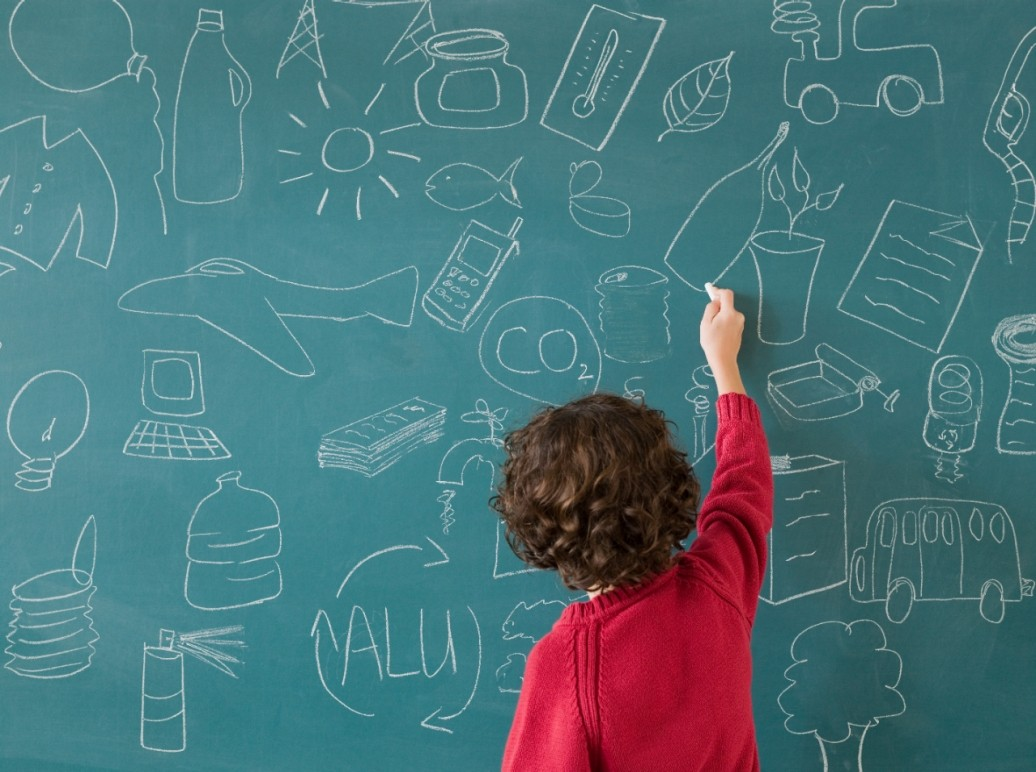 boy drawing on a blackboard