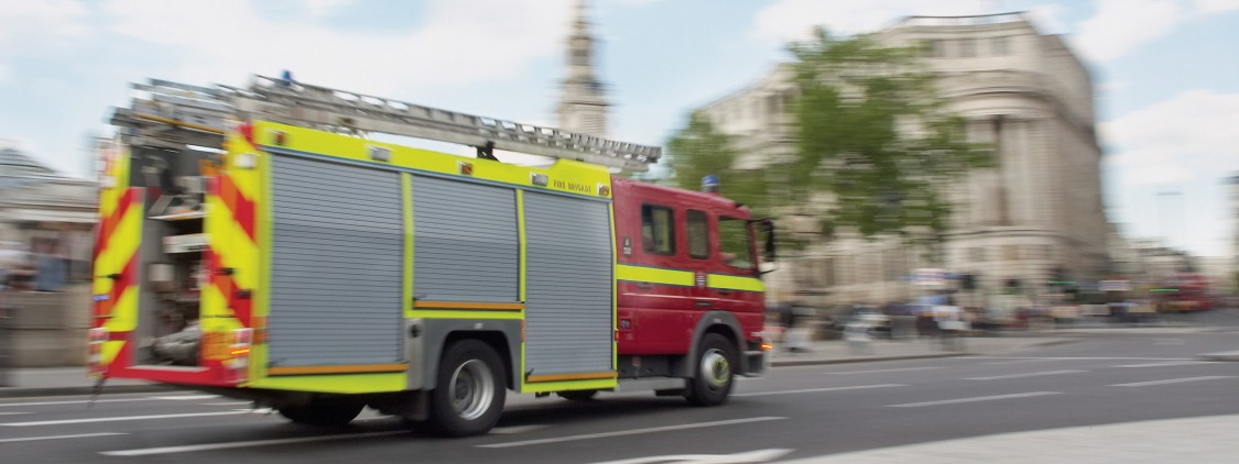Fire Engine on a Road by Trafalgar Square, London, England, United Kingdom