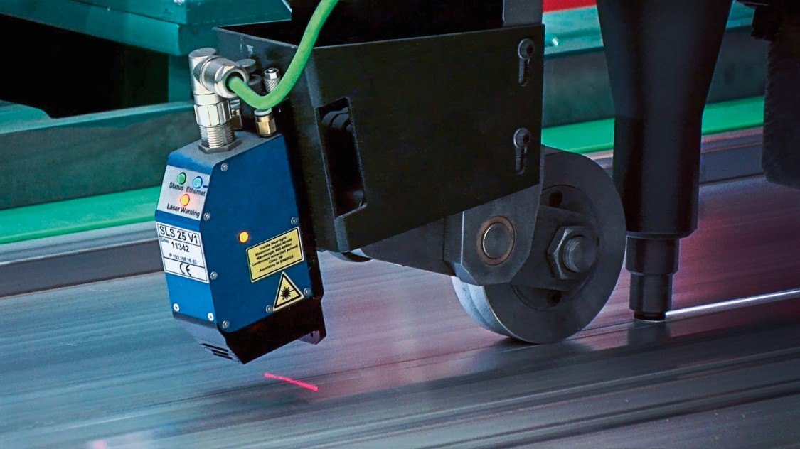 Automated welding robot processes the metal for the subsequent train car