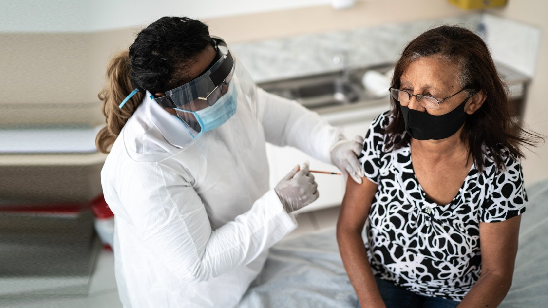 Woman receiving COVID-19 vaccination