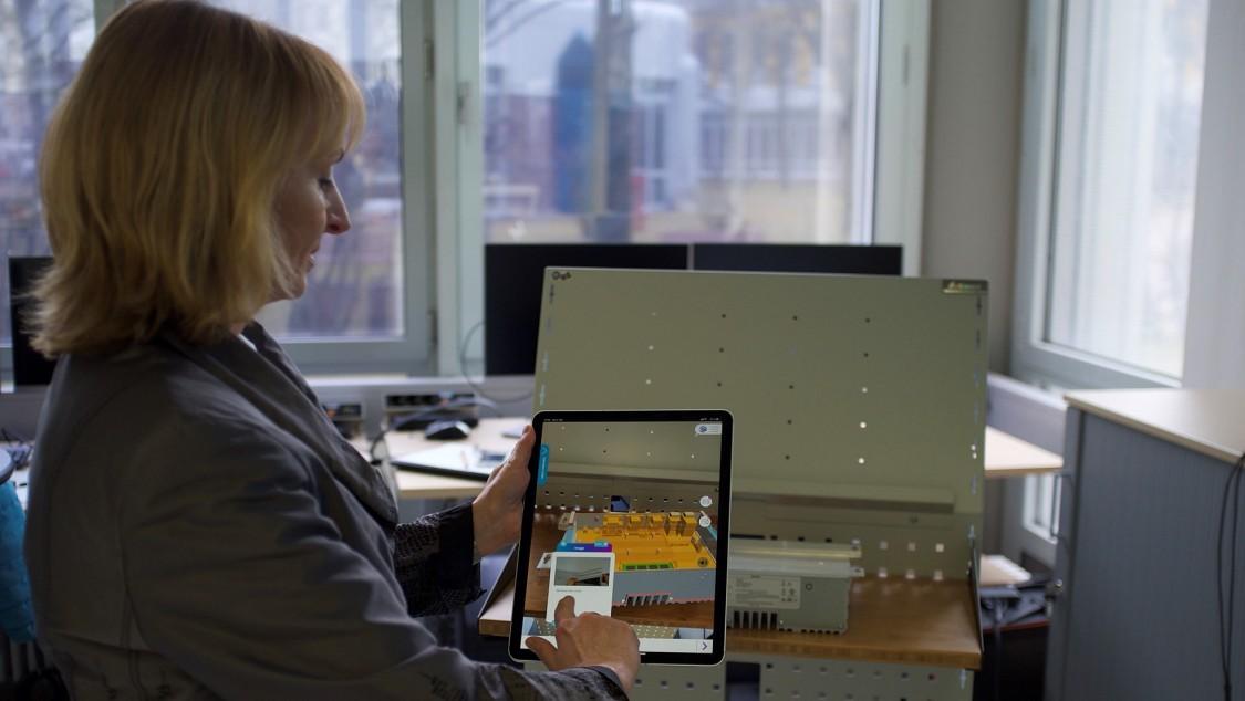 Anja Simon demonstrates augmented reality on a tablet