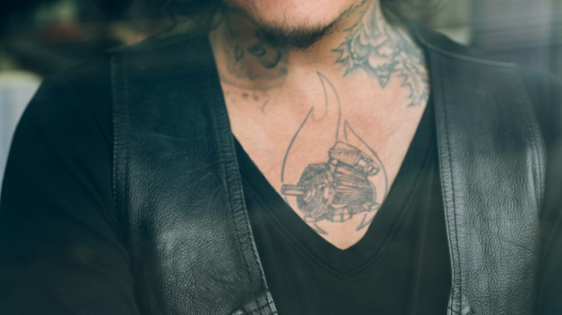 A male breast with tattoo