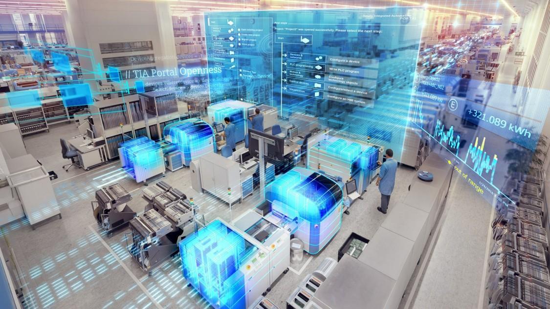 sala de computadores e máquinas com dois homens de jaleco azul trabalhando