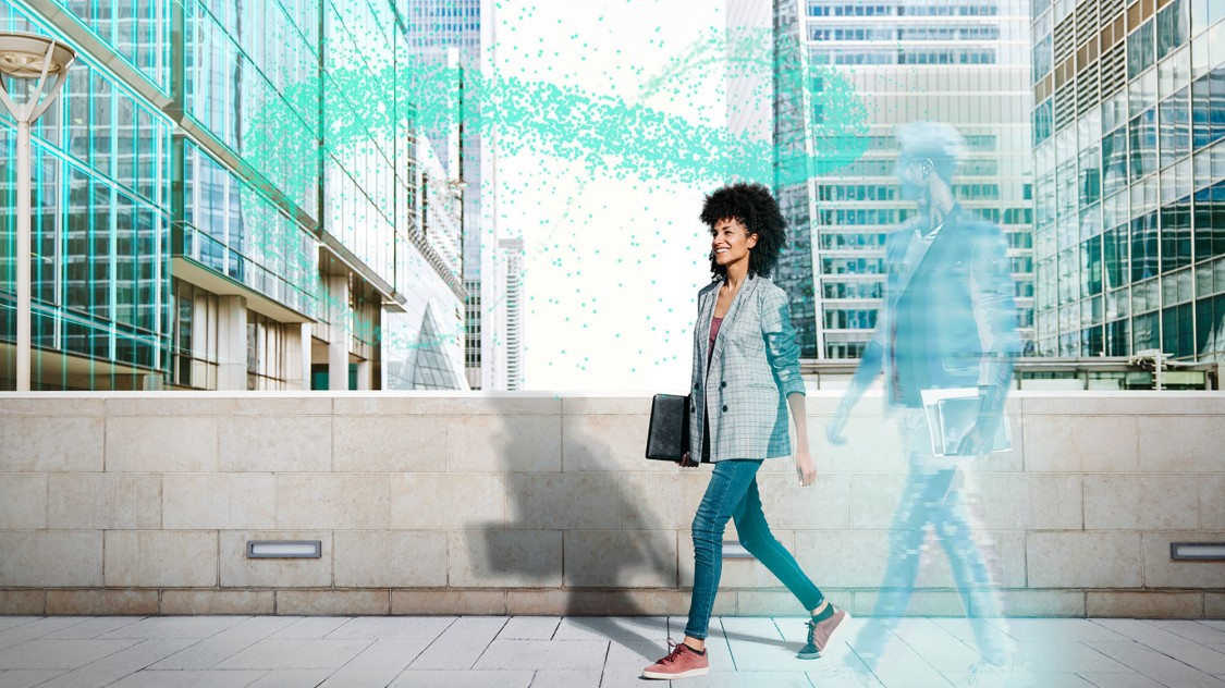 Woman walking at Siemens Smart Buildings Connect event