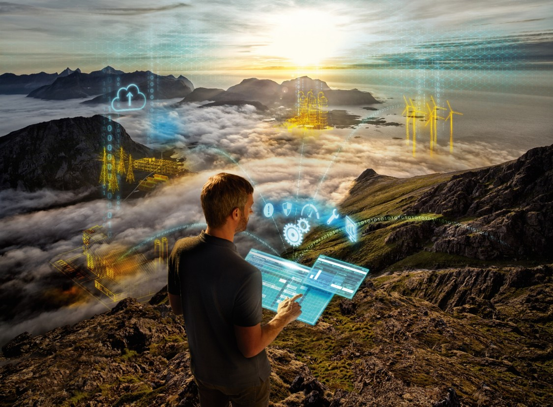 A man stands on a mountain. Digital graphic elements show the network management system he is using.