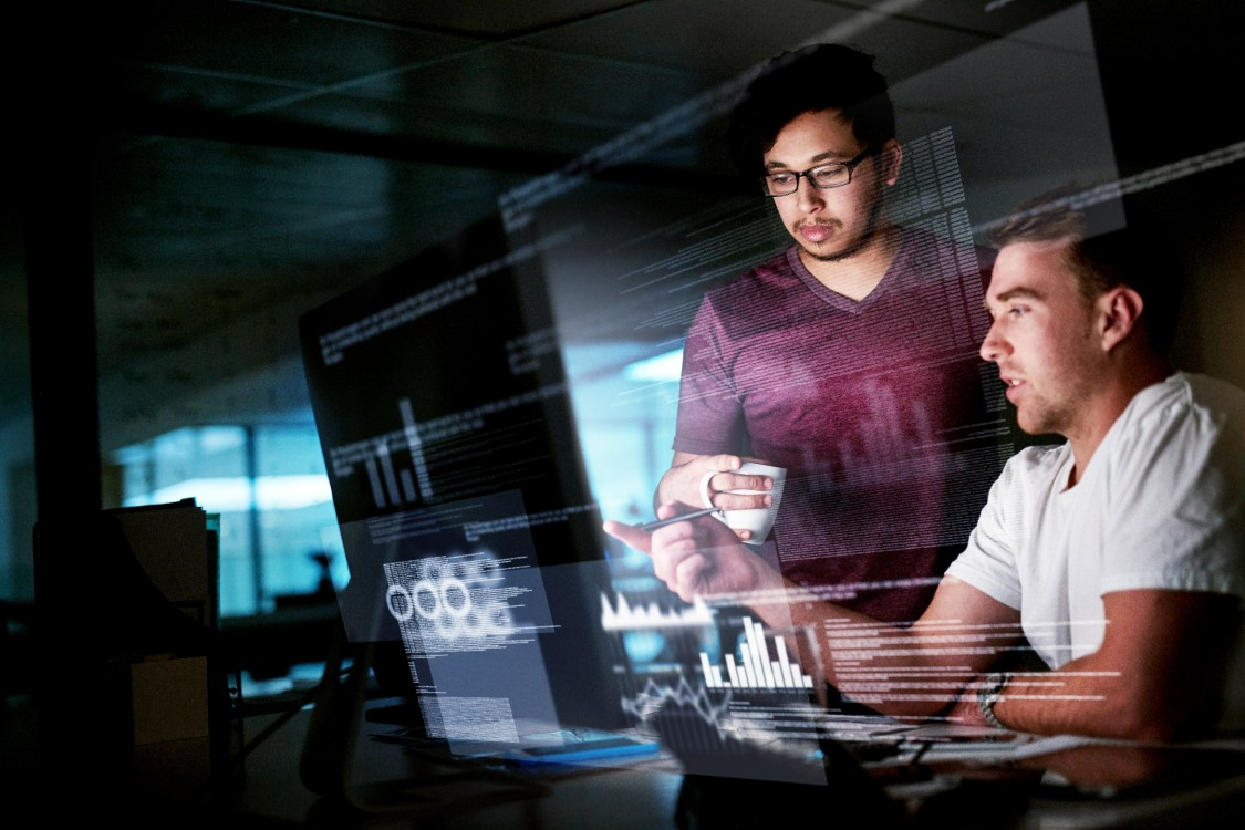 USA | 2 men looking at computer screens