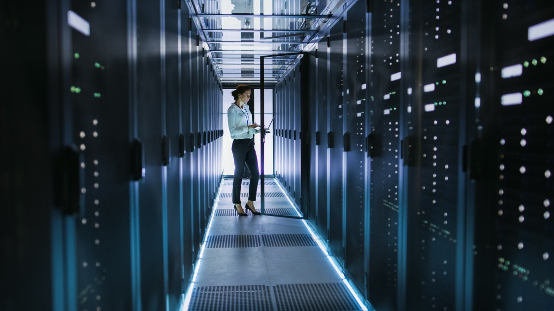 person in data centers room