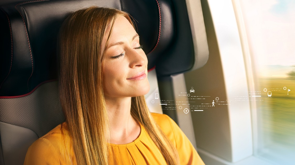 A passenger on a train enjoys an improved passenger experience with end-to-end journey touchpoints pictured using digital graphic elements