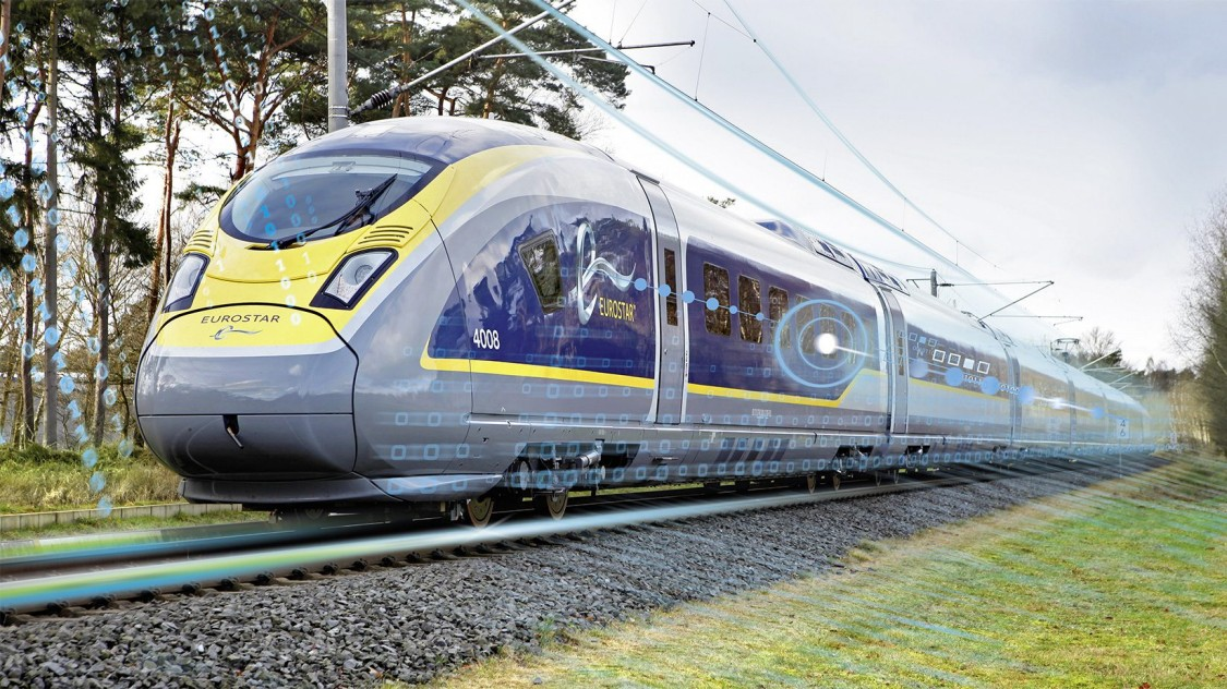 Picture of the Velaro Eurostar e320 from Siemens Mobility in diagonal view driving over a rail track standing for the Velaro high-speed platform.