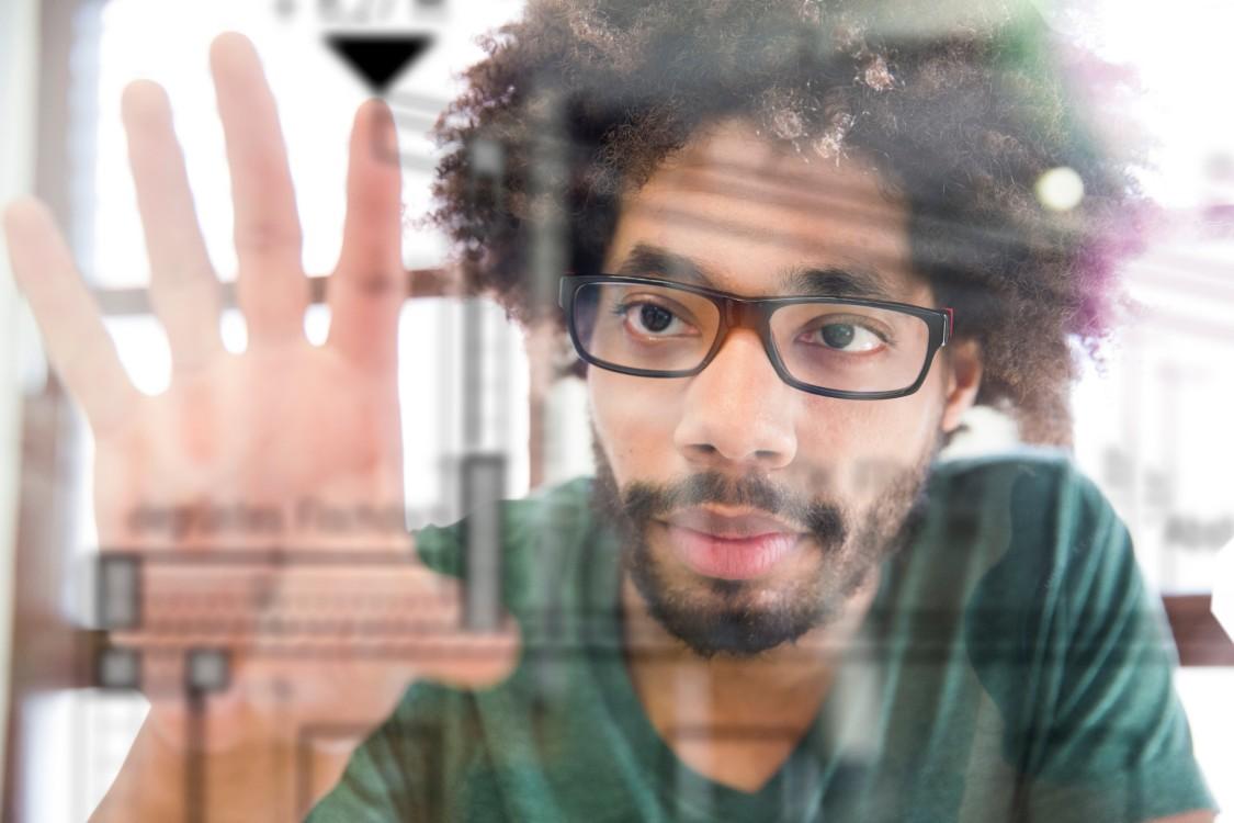 man using digital screens
