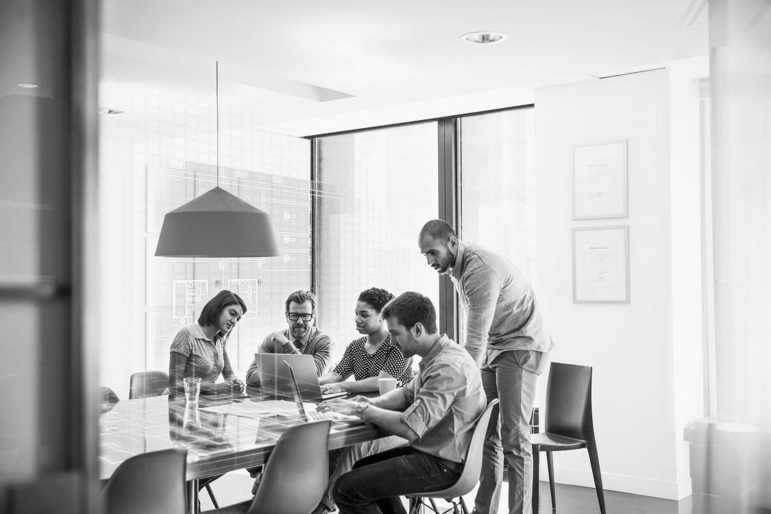 USA | Team working together at a table for Digital workshop
