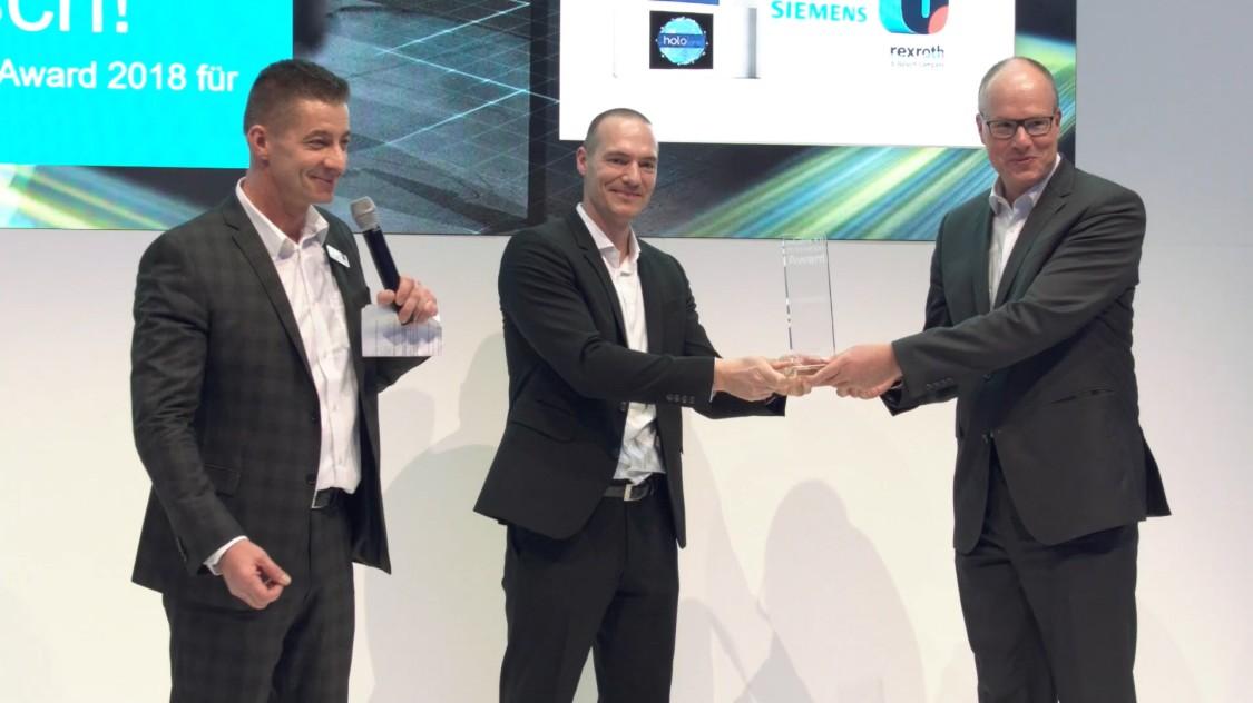 Bild von der Übergabe des Industrie 4.0 Innovation Award für SIDRIVE IQ