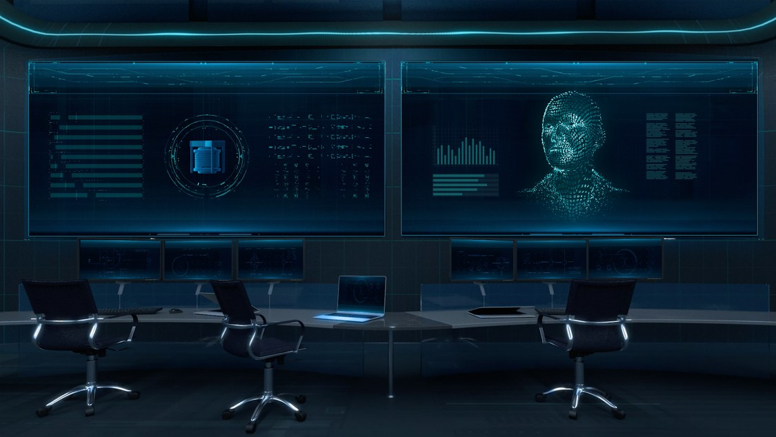 We're looking at a seemingly state-of-the-art control room. The entire room is bathed in dark blue. At the center of the image, three empty office chairs are placed in front of two large-format, wall-mounted displays showing screen contents from SIMATIC PCS neo.