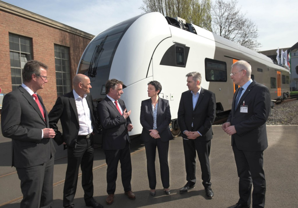 In the picture (starting from the left): Plant Manager Ulrich Semsek, Manfred Fuhg, Head of Siemens Mobility Division Region Germany; Transportation Minister of the state of North-Rhine-Westphalia Michael Groschek; CEO Siemens Business Unit Mainline Transport Sabrina Soussan, Siemens Rhein-Ruhr-Express Project Lead Jens Chlebowski and District Administrator of the Rheinisch-Bergisch district Dr. Hermann-Josef Tebroke.