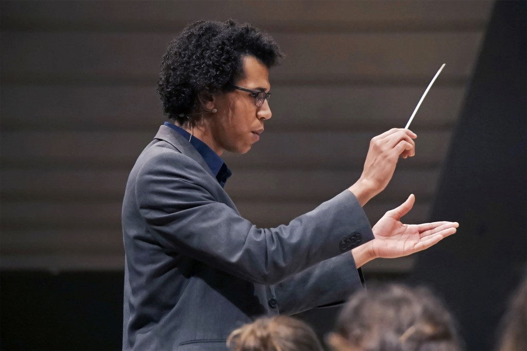 Jonathon Heyward, Assistant Conductor of the Hallé, performing at a concert