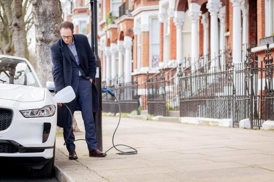 businessman charging his electric car