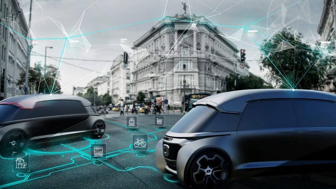 Zwei futuristisch gestaltete eAutos in einer urbanen Straße, um Hintergrund ein klassizistisches Wohnhaus. Über der Straße verlaufen grüne Linien, die digitale Vernetzung symbolisieren soll.