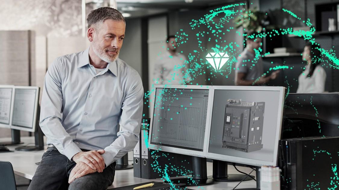 Ein Mann sieht auf einen Monitor, der einen stilisiert-digitalen offenen Leistungsschalter 3WA aussendet