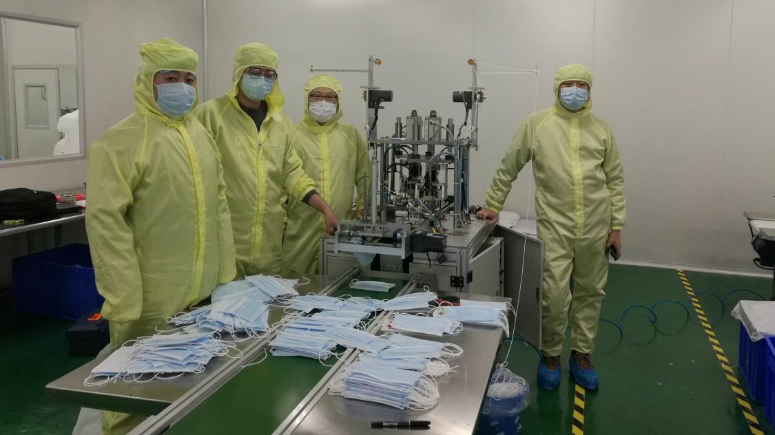 Equipe siemens da linha de produção de máscaras respiratórias na china