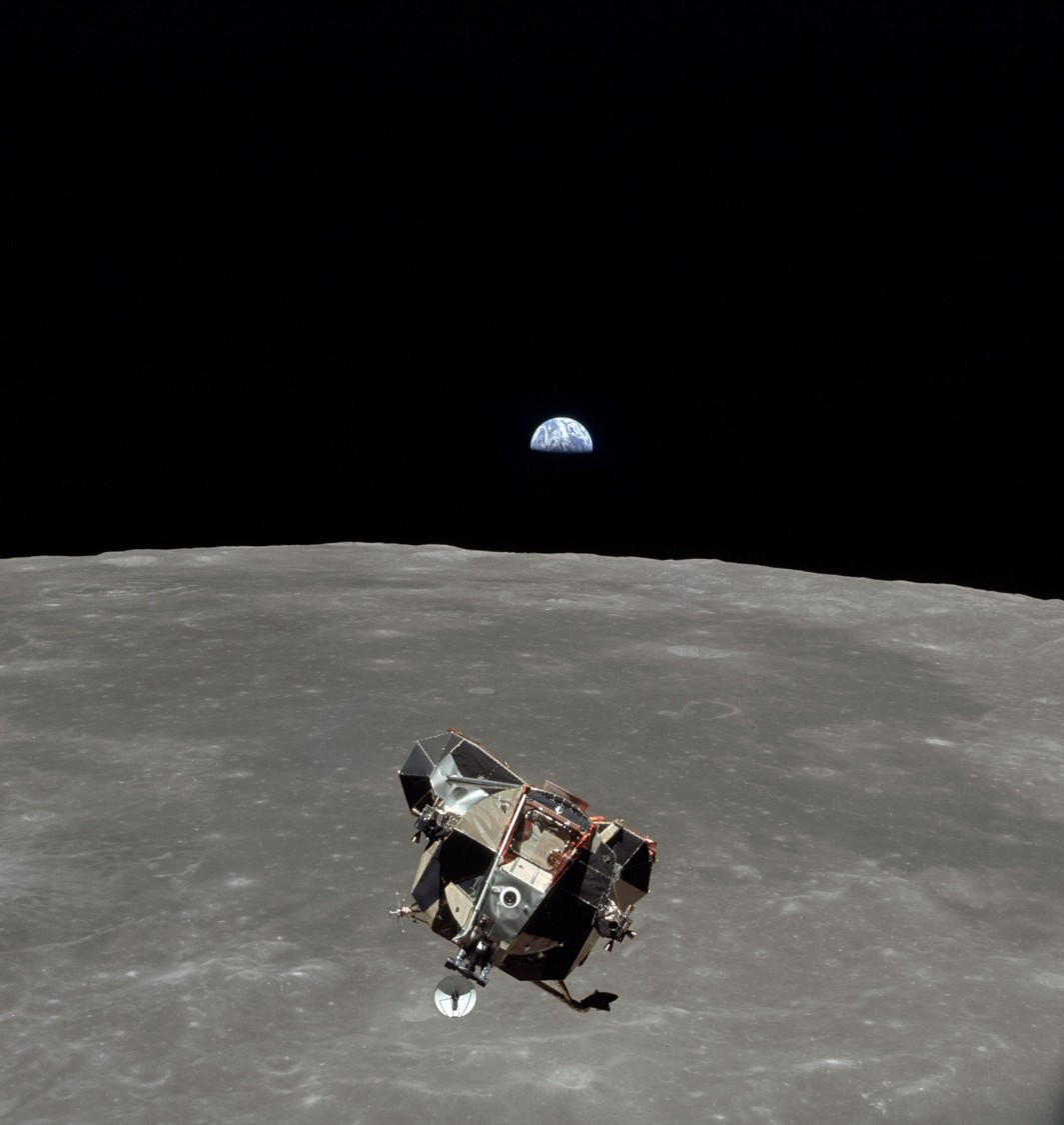 Lunar module Eagle flies over the moon