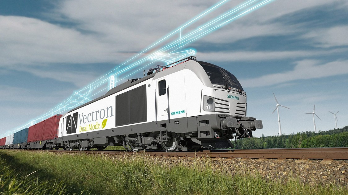 The Vectron Dual Mode in diagonal view on the track. An overhead line is shown in digital style .