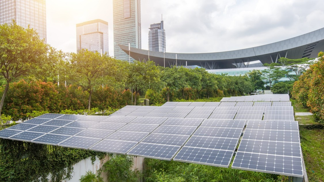 City skyline with solar panels in a field