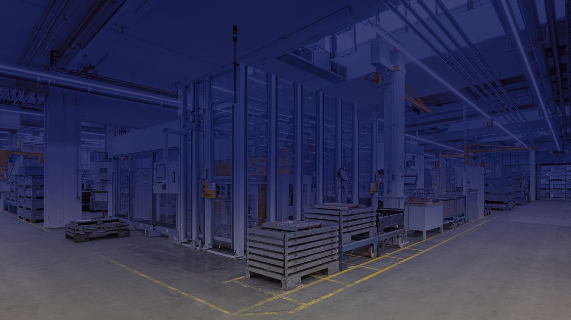 A blue colored photo of the manufacturing directly connected to the arena of digitization shows some workpieces.