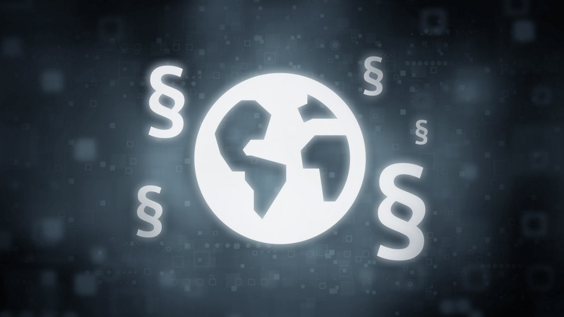 A dark digital icon shows a world globe with legal section signs around it