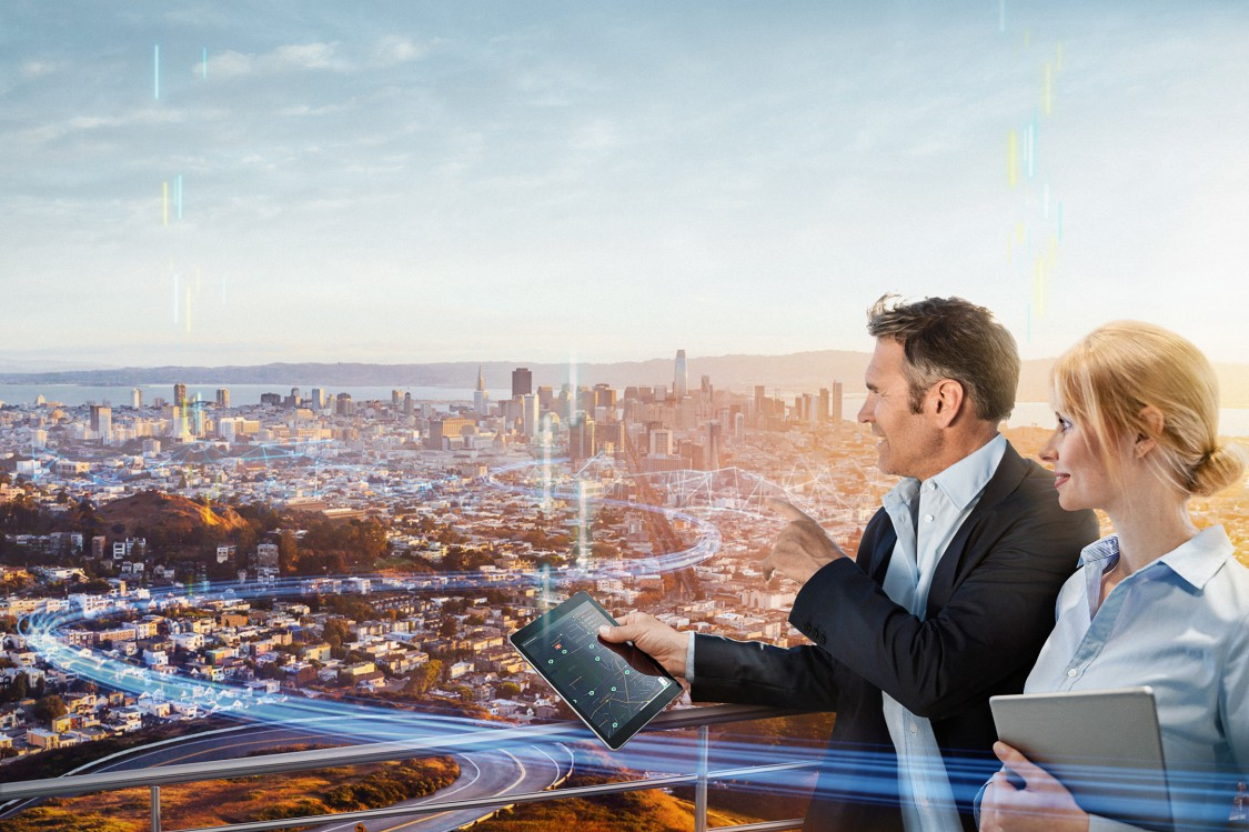 two business people view of a digitalized city