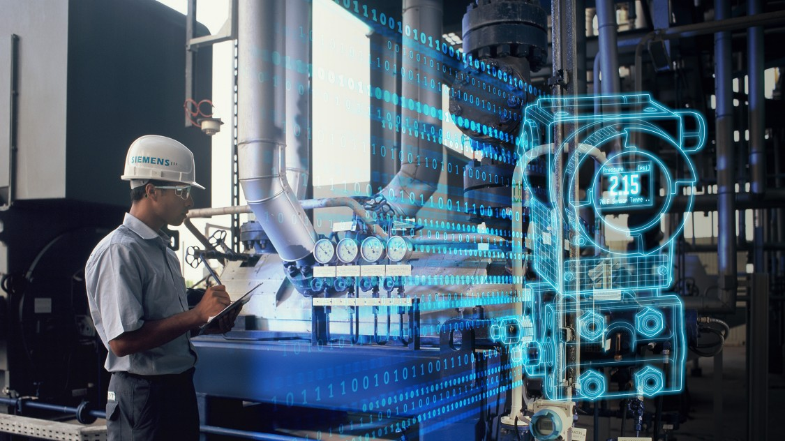 Employee using digital twin technology in factory