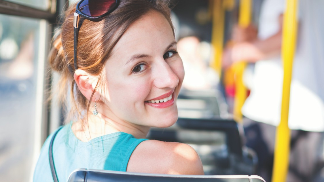 girl in sunglasses on a bus