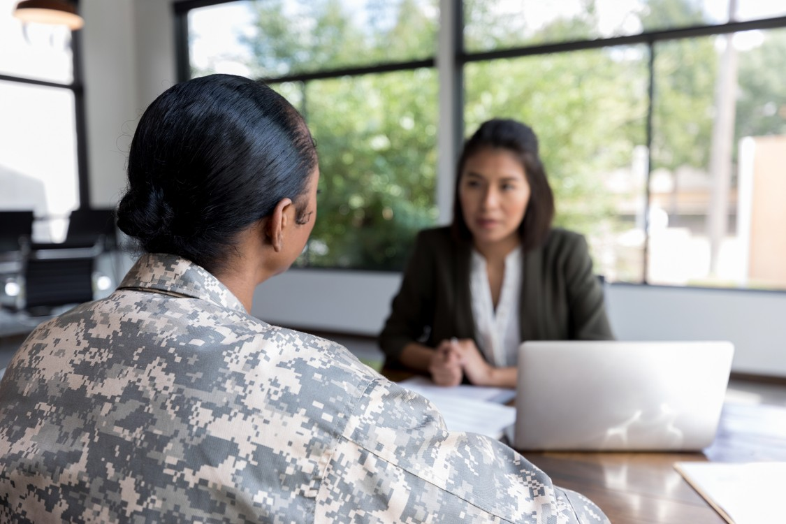 adult military veteran talks with a therapist