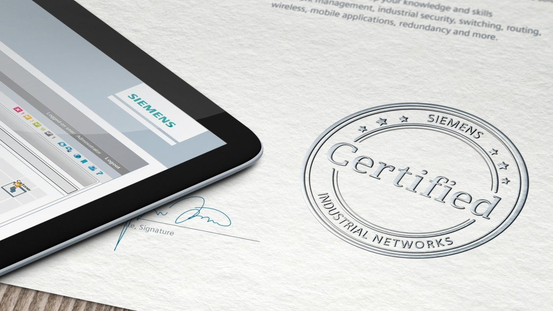 """The motif shows the certification stamp on a document - as a symbol for a successfully completed and certified Siemens training course on """"industrial communication networks"""". Also visible, in the cut: a tablet, which lies on the described document - on whose display the Siemens logo is to be seen."""
