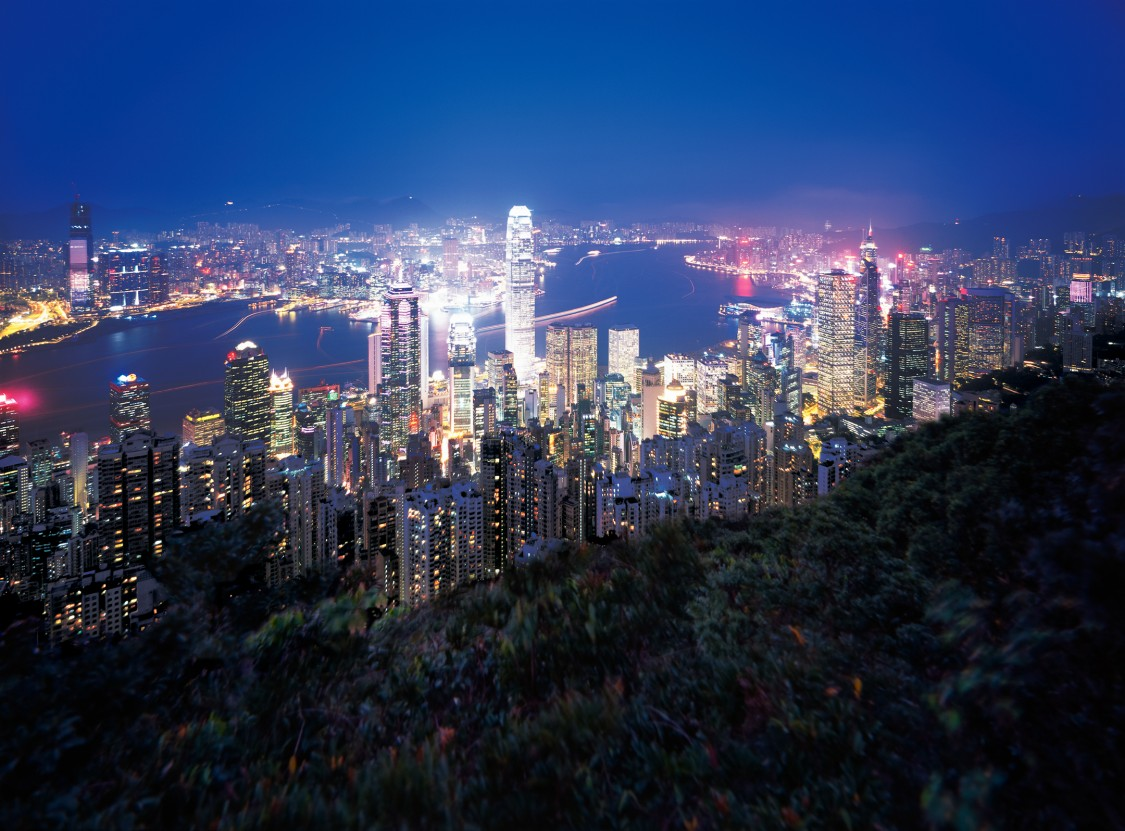 An image of Hong Kong by night demonstrates benefits of state-of-the-art traffic management systems for an improved passenger experience