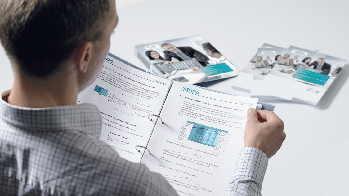 A man pages through SCE learning and training documents