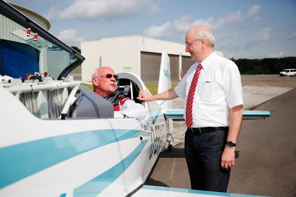 Pictured are Walter Extra (left), Extra Aircraft's founder, and Frank Anton, head of eAircraft at Siemens Corporate Technology.