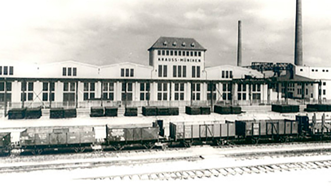 Em 1913, Krauss começa a planejar uma nova fábrica em Munique-Allach. A primeira fase da construção é concluída em 1922.