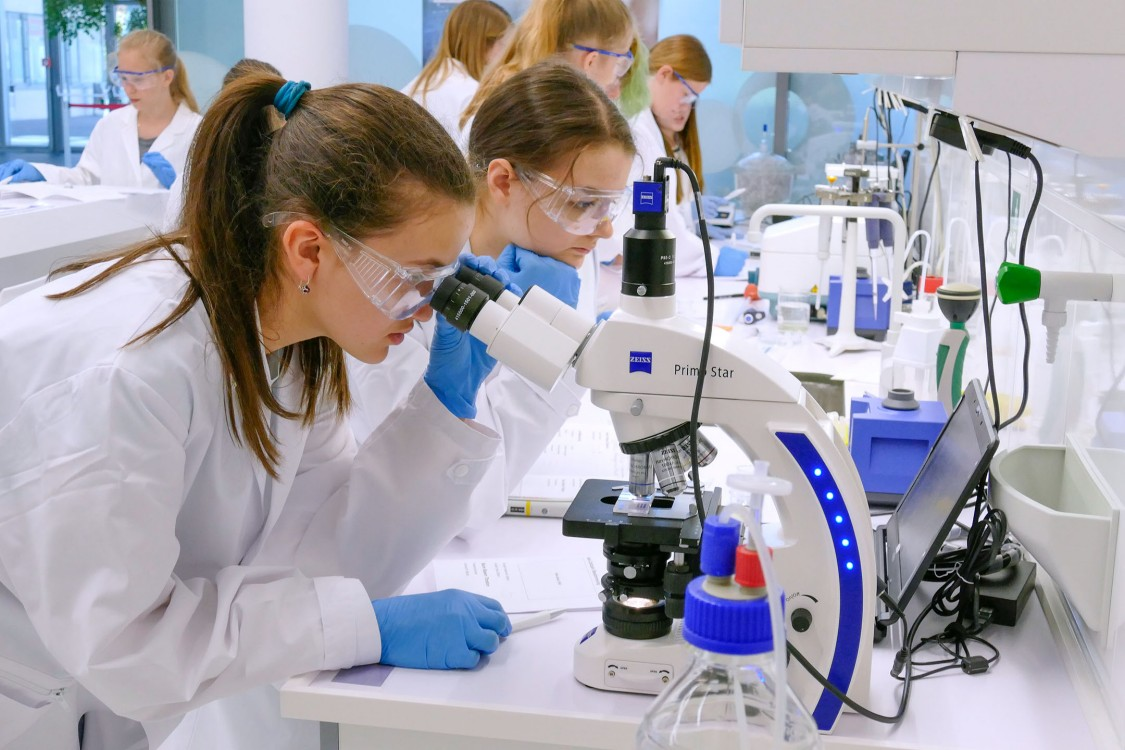Girls working with a microscope