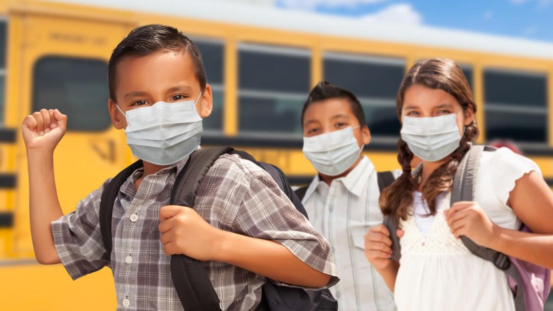 Children in front of a school bus
