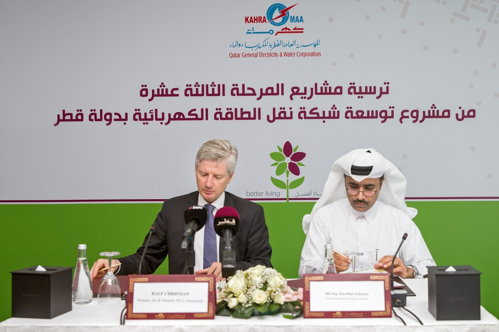 The picture shows Energy Management CEO Ralf Christian and Essa bin Hilal Al-Kuwari, President of KAHRAMAA, during the signing ceremony