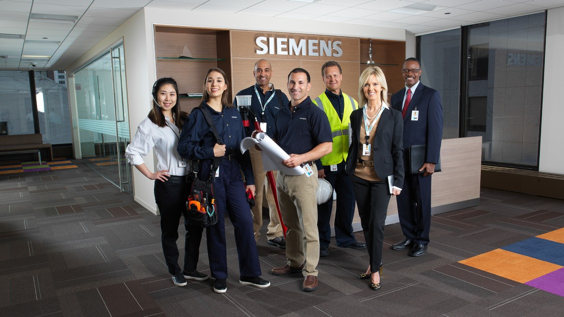 Siemens employees in the foyer of a Siemens location