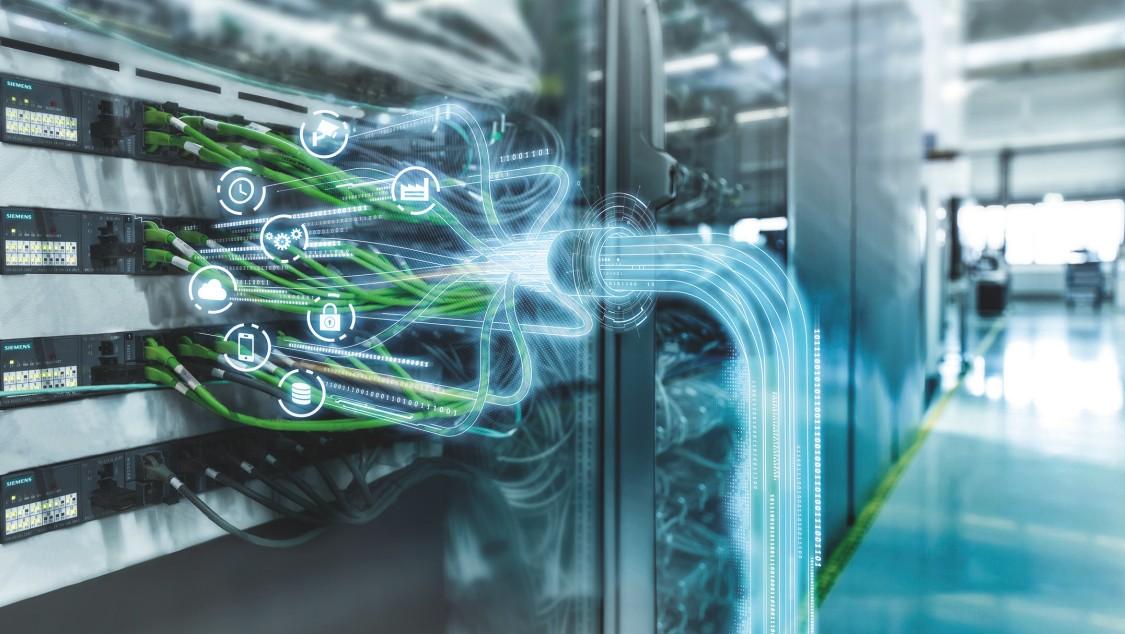 Spoustu Ethernetových kabelů zapojených do řídicí jednotky a znázorněných jako TSN Ethernetový standard