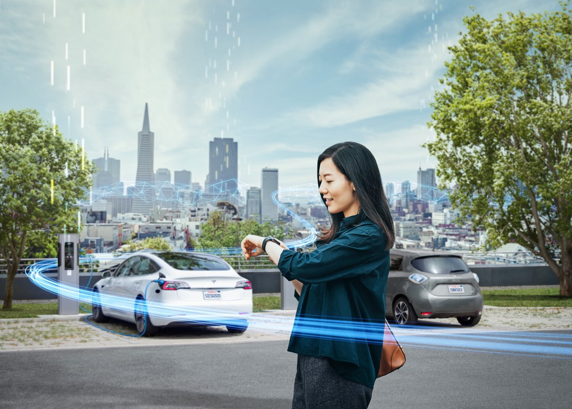 woman and her electric car