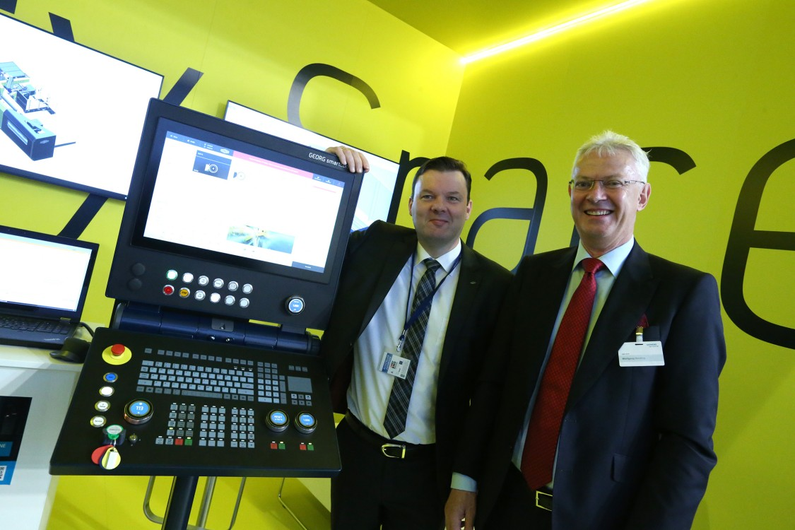 Dr. Wieland Klein, CTO Heinrich Georg, and Dr. Wolfgang Heuring, CEO Siemens Motion Control