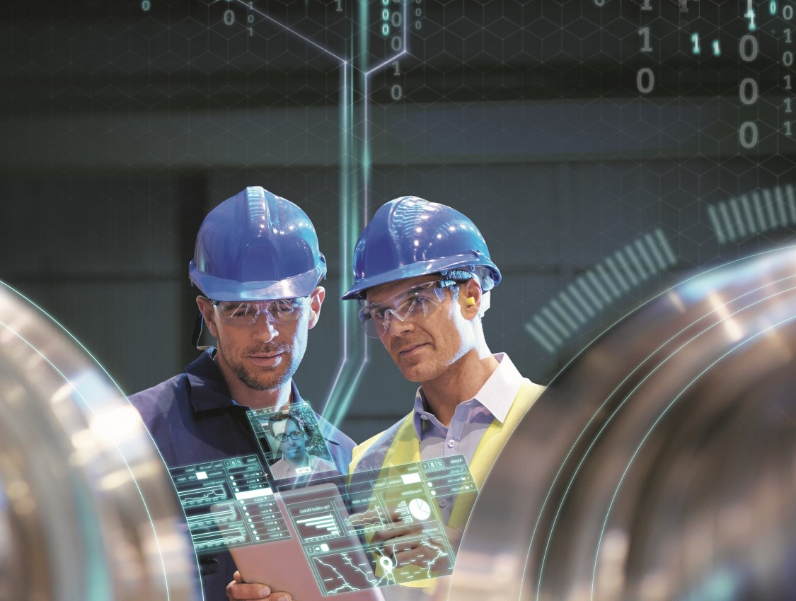 Colleagues wearing hard hats in digital factory