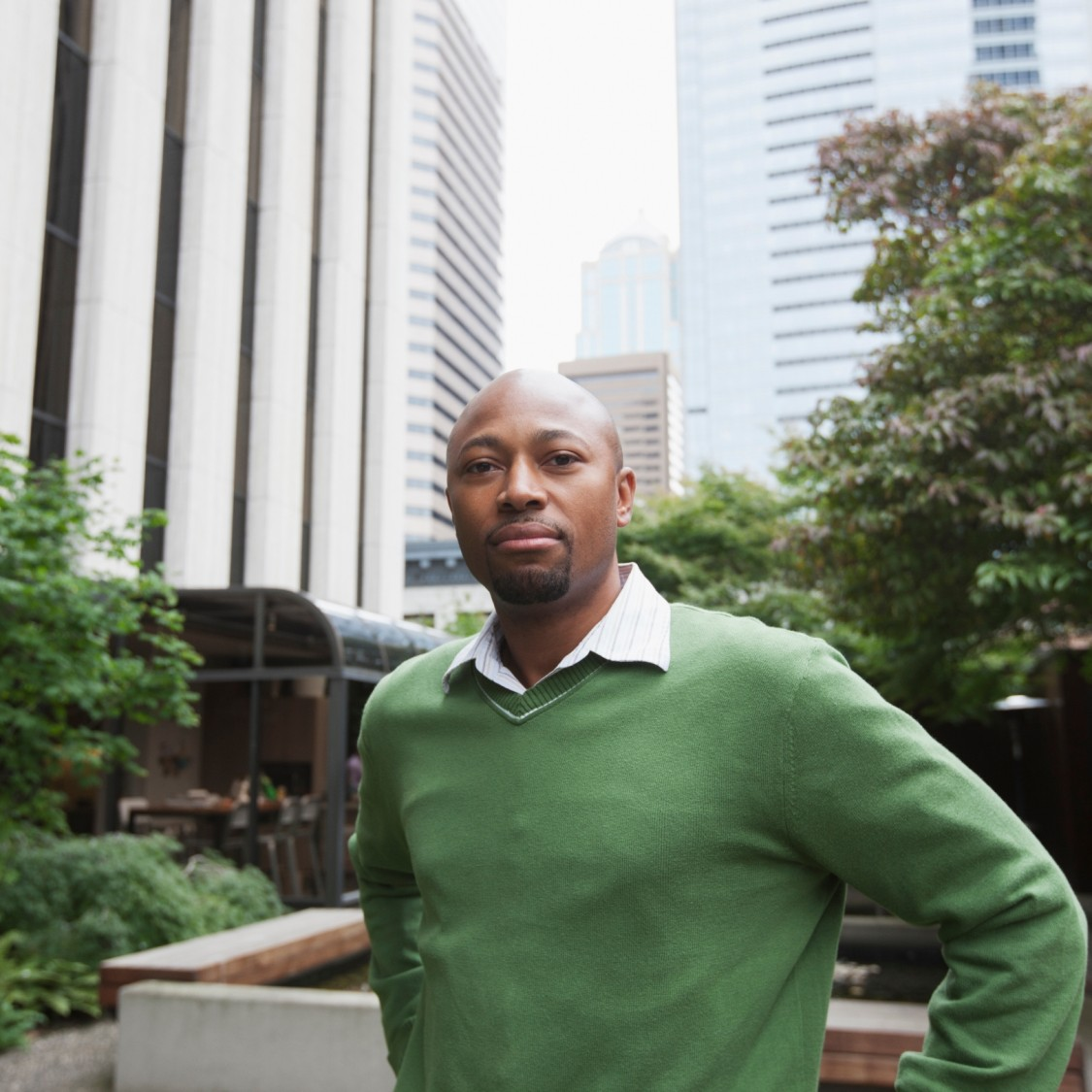 African American business man standing in front of office buildings