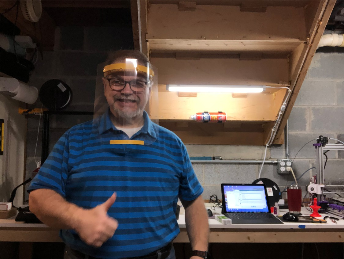 Siemens IT Systems Analyst Greg Siwicki is printing face shields for nurses at his home in Detroit, Michigan.