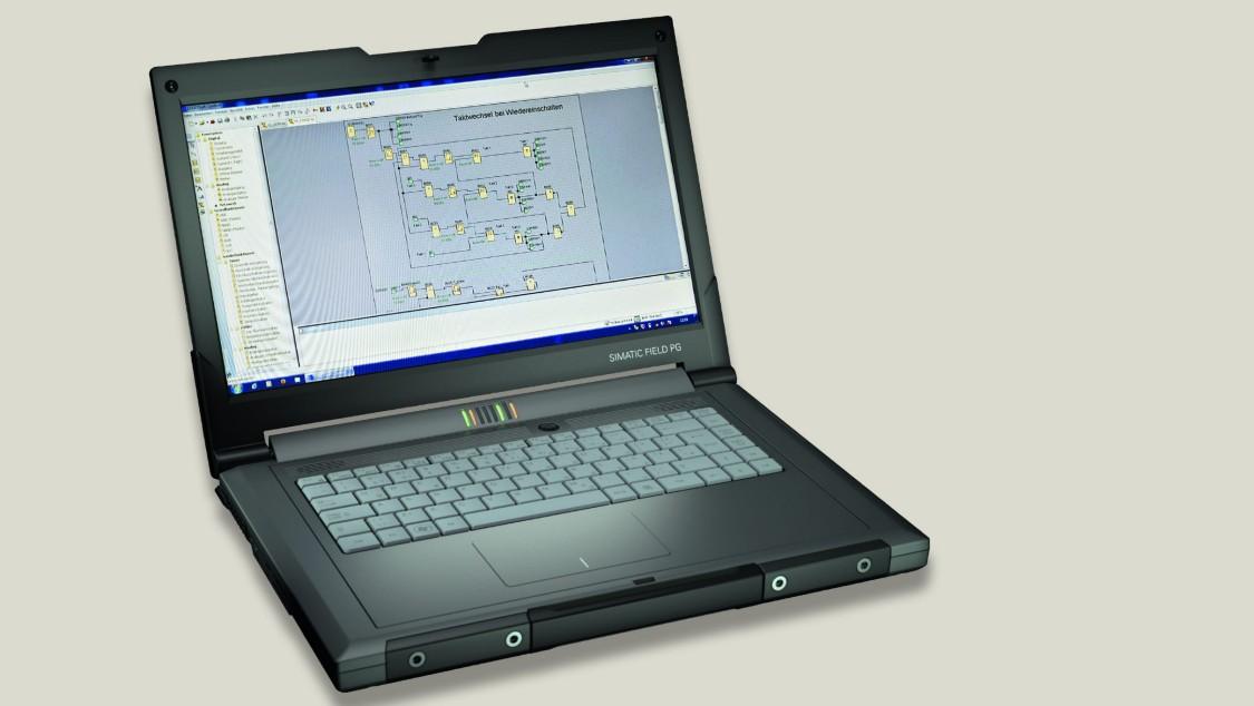 notebook preto escurto aberto com tela mostrando interface do software logo da siemens