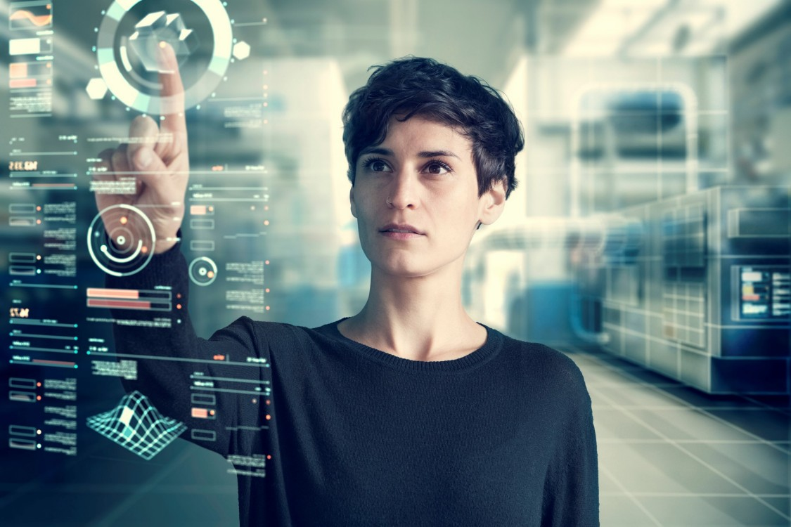 Humans and the IoT - a woman working on a cyber digital display